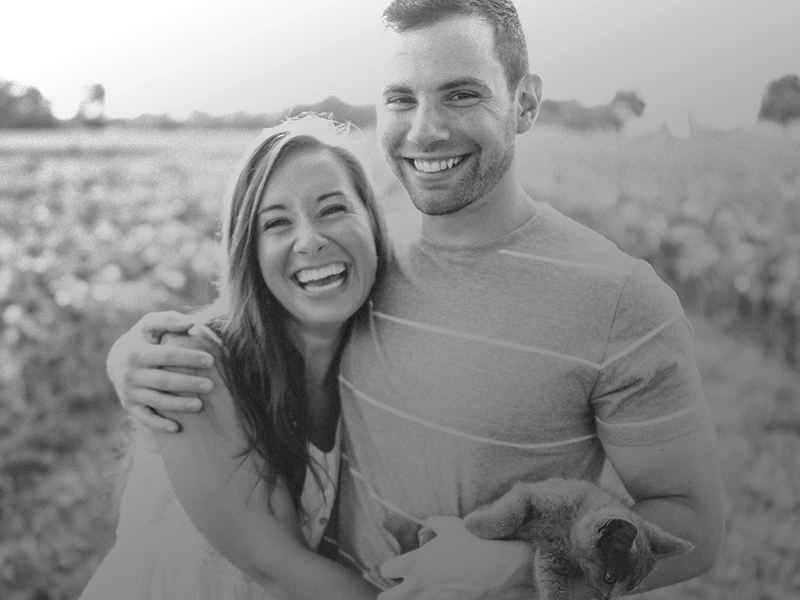 black and white image of smiling and laughing couple for ccfil about us page
