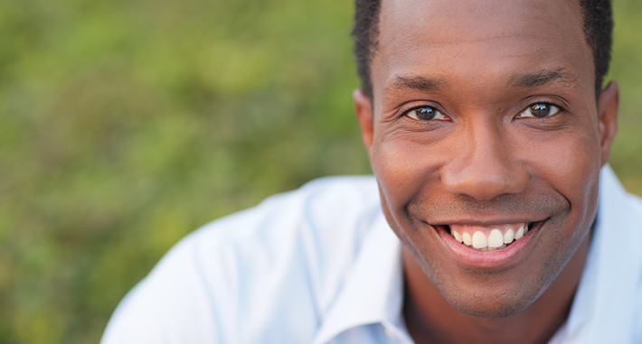 image of man smiling for campus life page
