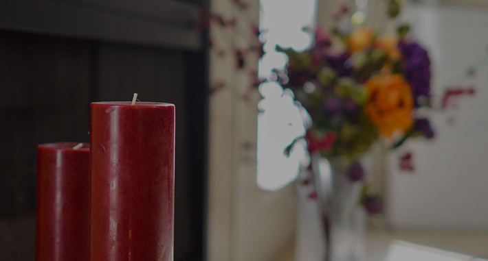 image of red candles and flowers